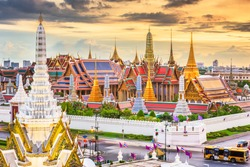 Bangkok, Thailand at the Temple of the Emerald Buddha and Grand Palace at dusk.