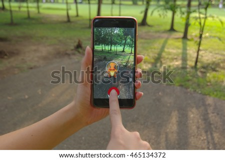 Bangkok, Thailand - Aug 6, 2016 : Apple iPhone6s held in one hand showing its screen with Pokemon Go application. #465134372