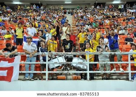 BANGKOK,THAILAND - AUG 24  ; Football Fanclub of Thailand during friendly football match between Thailand (Y) and Singpore (R) at Rajamagala Stadium on Aug. 24, 2011  Bangkok Thailand