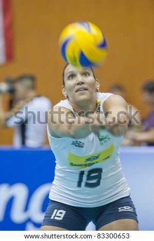 BANGKOK,THAILAND - AUGUST 21 : C.Tandara (19) in action during Volleyball World Championships 2011 Thailand vs Brazil on August 21, 2011 in Bangkok,Thailand