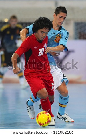 BANGKOK,THAILAND AUGUST24:Jirawat Sornwichian (red no.20) of Thailand in action during Friendly match between Thailand and Spain at Nimibutr Stadium on August24,2012 in Bangkok Thailand