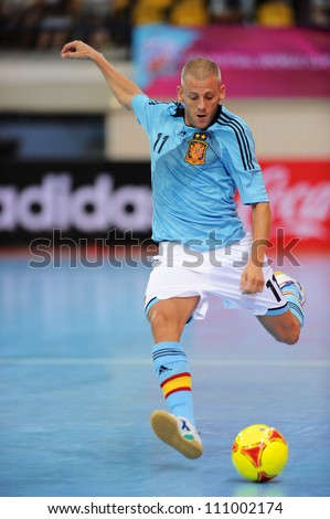 BANGKOK,THAILAND AUGUST24:Miguel Sayago (blue) of Spain in action during Friendly match between Thailand and Spain at Nimibutr Stadium on August24,2012 in Bangkok Thailand