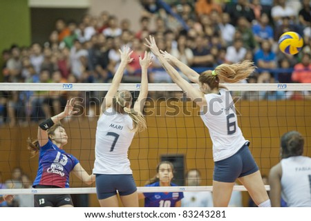 BANGKOK,THAILAND - AUGUST 21 : S.Marianne (7) and M.Thaisa in action during Volleyball World Championships 2011 Thailand vs Brazil on August 21, 2011 in Bangkok,Thailand