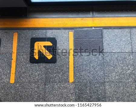 Bangkok, Thailand BTS station that have a sign to show passenger where they should stand while waiting for BTS. Transportation concept.