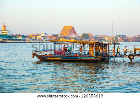 BANGKOK, THAILAND - DEC 23: people in the boat at the river Mae Nam Chao Phraya on December 23,2009 in Bangkok, Thailand. More than 15 boat lines operate on the river including commuter lines.