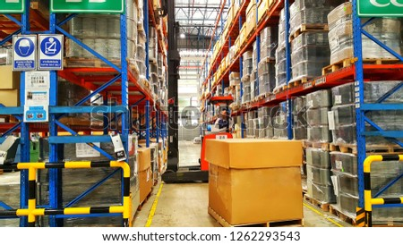 Bangkok, THAILAND Dec 04, 2018:  The forklift driver lifts up the goods on a shelf in Warehouse. #1262293543