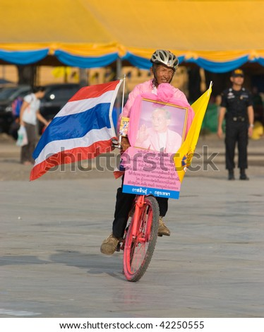 BANGKOK, THAILAND - DECEMBER 5: Bicycle rider celebrating the 82nd birthday of H.M. King Bhumipol Adulyadej at Sanam Luang on December 5 2009 in Bangkok, Thailand.