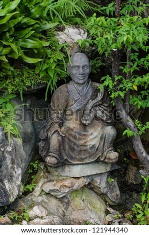BANGKOK, THAILAND - December 13: Chinese Statue on 13 December 2012 at ancient buddhist Temple   (Wat Pho), Bangkok, Thailand