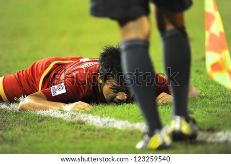 BANGKOK THAILAND-DECEMBER 13:Datsakorn Thonglao of Thailand in action during the AFF Suzuki Cup between Malaysia and Thailand at Supachalasai stadium on Dec13,2012 in Bangkok,Thailand.