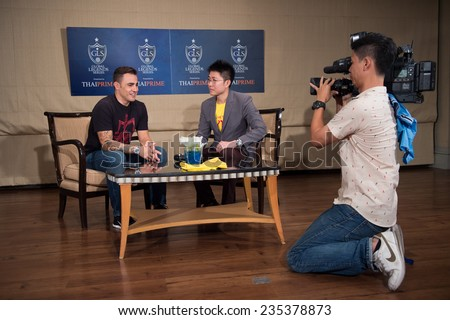 BANGKOK, THAILAND - DECEMBER 03: Fabio Cannavaro  (L)speaks to the media during a press conference in the lead up to the Global Legends Series, at the Swissotel, on Dec3, 2014 in Bangkok, Thailand.