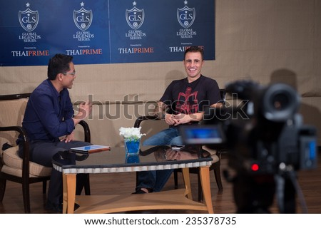 BANGKOK, THAILAND - DECEMBER 03: Fabio Cannavaro  (R)speaks to the media during a press conference in the lead up to the Global Legends Series, at the Swissotel, on Dec3, 2014 in Bangkok, Thailand.
