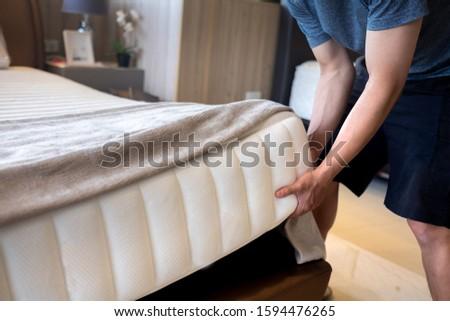 Bangkok / Thailand - December 14, 2019 : man lift mattress test weight
