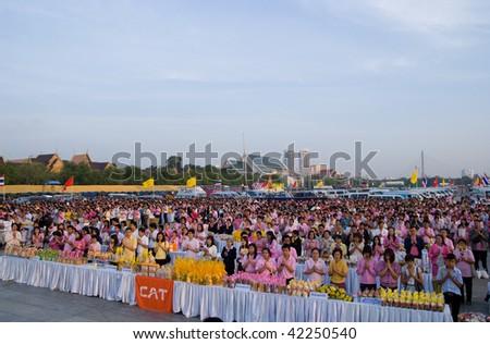 BANGKOK, THAILAND - DECEMBER 5: Morning prayer at Sanam Luang in Bangkok during the celebration of the 82nd birthday of H.M. King Bhumipol Adulyadej on December 5 2009 in Bangkok, Thailand.