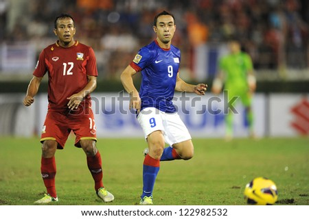 BANGKOK THAILAND-DECEMBER 13:Norshahrul Idlan Talaha #9 of Malaysia (blue) in action during the AFF Suzuki Cup between  Malaysia and Thailand at Supachalasai stadium on Dec13, 2012 in,Thailand.