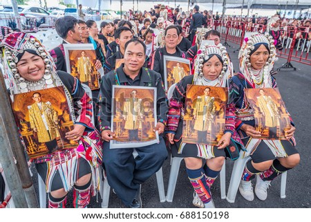 Bangkok, Thailand. December 12,2016 : Thai hill tribe people holding king bhumibol(Rama 9) at  royal field for pay respect to the king  funeral ceremony in Bangkok of Thailand. #688150198