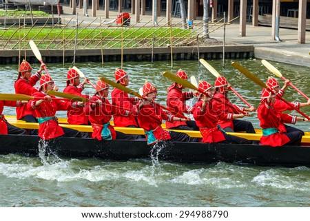 BANGKOK, THAILAND - DECEMBER 17: Thai Royal Barge in Bangkok, Thailand on December 17, 2014. Unidentified group of Thai royal marines re�·hearse the sail of the Thai royal barge procession