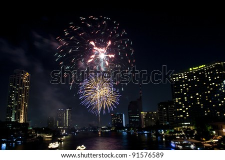 BANGKOK, THAILAND - DECEMBER 24: The fireworks to celebrate Christmas Eve at chao phaya river on december 24,2011 in bangkok, thailand.