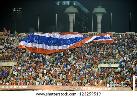 BANGKOK THAILAND-DECEMBER 13:unidentified fans of Thailand Flag supporters  during the AFF Suzuki Cup between Malaysia and Thailand at Supachalasai stadium on Dec13,2012 in Bangkok,Thailand.