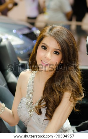 BANGKOK, THAILAND - DECEMBER 6: Unidentified female presenter at Mazda booth in THE 28th THAILAND INTERNATIONAL MOTOR EXPO 2011 on December 6, 2011 in Bangkok, Thailand.