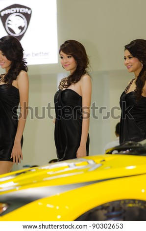 BANGKOK, THAILAND - DECEMBER 6: Unidentified female presenter at Proton booth in THE 28th THAILAND INTERNATIONAL MOTOR EXPO 2011 on December 6, 2011 in Bangkok, Thailand.