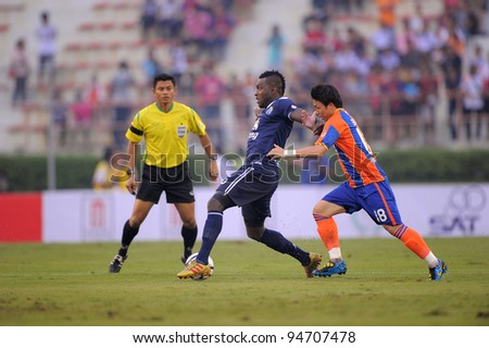 BANGKOK,THAILAND-FEB 4: Frank Ohandza (blue) of Buriram PEA in action during the Toyota league cup final between Buriram PEA and Thai Port FC.at National Stadium on Feb 4, 2012 in Bangkok, Thailand.