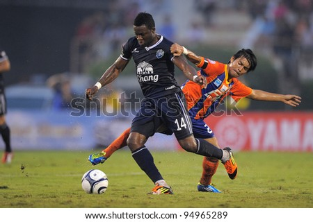 BANGKOK,THAILAND-FEB 4:Frank Ohandza (blue) of Buriram PEA in action during the Toyota league cup  Buriram PEA and Thai Port FC.at National Stadium on FEB 4, 2012 in Bangkok, Thailand.