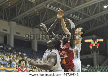 BANGKOK, THAILAND - FEB 5 : Louis Graham (red) in action during Asean Basketball League 2012 (ABL) between Slammers(W) vs Leader(R) at Thai-Japanese Stadium on February 5, 2012 in Bangkok, Thailand
