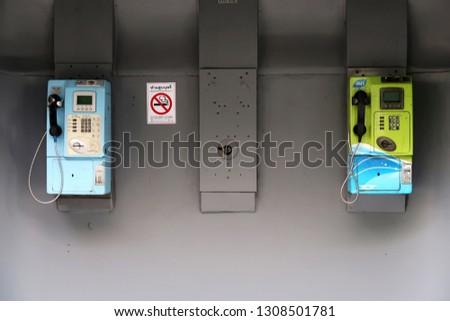 Bangkok/Thailand - 6 Feb 2019 :  Remaining pay public telephone booth in Bangkok, with no customer. #1308501781