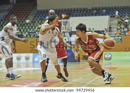 BANGKOK, THAILAND - FEB 5 : W.Long Wong (R) in action during Asean Basketball League 2012 (ABL) between Slammers(W) vs Leader(R) at Thai-Japanese Stadium on February 5, 2012 in Bangkok, Thailand