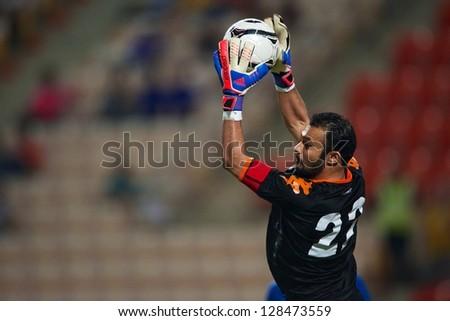 BANGKOK THAILAND-FEBRUARY06 :Goalkeeper Nawaf Al-Khaldi of Kuwait in action during the football 2015 Asian Cup qualifying between Thailand and Kuwait at Rajamangala stadium on Feb 06, 2013 in,Thailand. - stock photo
