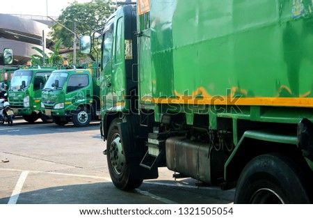 Bangkok/Thailand - February 22,2019 : Green garbage trucks in Bangkok city #1321505054