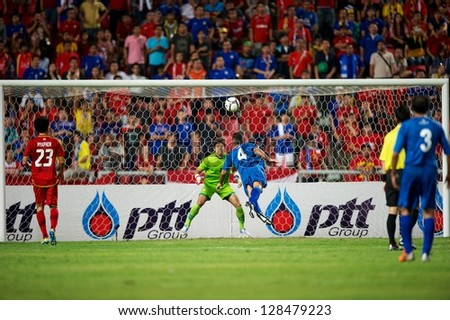 BANGKOK THAILAND-FEBRUARY 06:Nasser Al Wuhaib #4 of Kuwait  in action during the football 2015 Asian Cup qualifying between Thailand and Kuwait at Rajamangala stadium on Feb 06,2013 in,Thailand. - stock photo