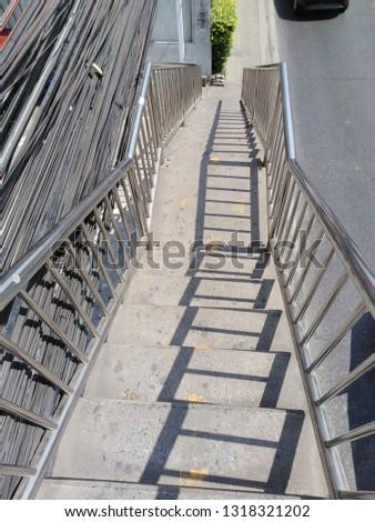 Bangkok,Thailand,February 18,2019 Shadow on the stairs down the bridge #1318321202