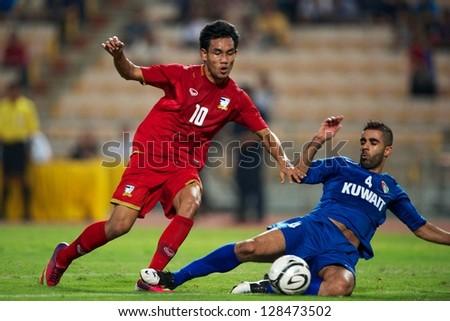 BANGKOK THAILAND-FEBRUARY 06:Teerasil Dangda of Thailand in action during the football 2015 Asian Cup qualifying  between Thailand and Kuwait at Rajamangala stadium on Feb 06, 2013 in,Thailand.