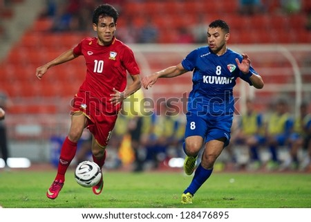BANGKOK THAILAND-FEBRUARY 06:Teerasil Dangda (red)of Thailand in action during the football 2015 Asian Cup qualifying  between Thailand and Kuwait at Rajamangala stadium on Feb 06, 2013 in,Thailand.