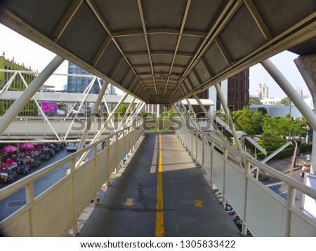 BANGKOK THAILAND-05 February 2019::The bridge over the road has a triangular structure building is located in the (Soi Ari ) Phaholyothin area.on BANGKOK THAILAND-05 February 2019. #1305833422