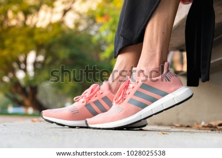 6a11cdd6 BANGKOK, THAILAND - FEBRUARY 17, 2018 : Women wearing adidas swift run w  2017