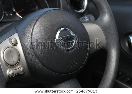 BANGKOK, THAILAND - FEBRYARY 21, 2015: Logo of Nissan car on steering wheel on February 22,2015 in Bangkok Thailand. #254679013