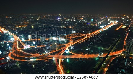 BANGKOK, THAILAND-JAN 05: Aerial cityscape view from Baiyok Tower of spanning express way and modern buildings at night on January 05, 2013 in Bangkok, Thailand.