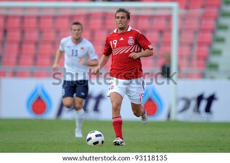 BANGKOK THAILAND-JAN15:Poulsen Jakob (19)of Denmark in action during the 41st King's cup football tournament between Norway and Denmark at Rajamangala stadium on Jan 15, 2012 Bangkok, Thailand.