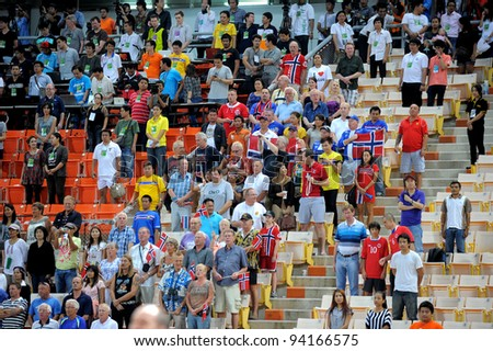 BANGKOK THAILAND-JAN18: Spectators watch and cheer of Norway  during the 41st King's cup football between Thailand(Y) and Norway(R)at Rajamangala stadium on Jan18, 2012 in Bangkok,Thailand.