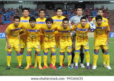 BANGKOK THAILAND-JAN18: Thailand team shoot photo  before start games during the 41st King's cup football between Thailand(Y) and Norway(R)at Rajamangala stadium on Jan18, 2012 in Bangkok,Thailand.