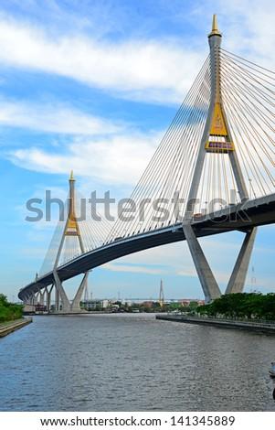 BANGKOK, THAILAND-JAN 14: The Bhumibol Bridge, also known as Industrial Ring bridge on Jan 14, 2013 in Bangkok. It is a part of 13 km long Industrial Ring Road connecting Bangkok with Samut Prakan. #141345889