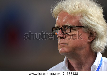 BANGKOK THAILAND-JAN18:Winfried Schafer Coach of Thailand in action during the 41st King's cup football between Thailand(Y) and Norway(R)at Rajamangala stadium on Jan18, 2012 in Bangkok,Thailand.