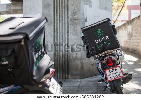 BANGKOK, THAILAND - JANUARY 27, 2017: An Uber Eats two motor scooter parked on the side of the road.