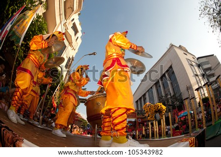 BANGKOK- THAILAND-JANUARY 24: Chinese Lion jumping on the Mei flower poles in Chinese New Year Festival on January 24, 2012 in Bangkok. It hesitates for further jumping or going back.