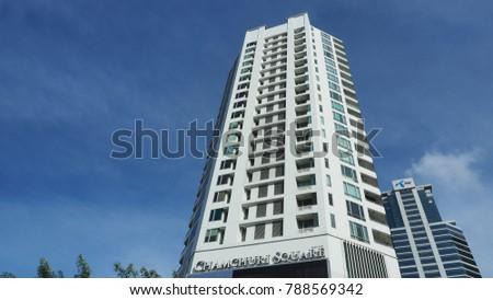 BANGKOK, THAILAND - JANUARY 7, 2018: 24-floor high Chamchuri residence rises in blue sky on January 7, 2018 in Pathumwan district of Thai capital Bangkok.