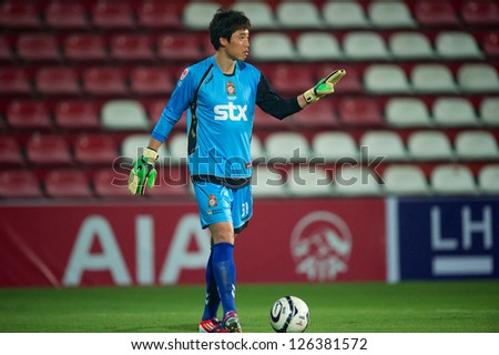 BANGKOK,THAILAND-JANUARY 22: Goalkeeper Back Min-Chul of Gyeongnam FC in action during The Friendly Match between SCG Muangthong Utd.and Gyeongnam FC at SCG Stadium on Jan 22, 2013 in,Thailand.
