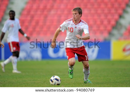 BANGKOK THAILAND-JANUARY 15:Juelsgaard Jesper of Denmark (white) in action during the 41st King's cup match between Korea Rep and Denmark at Rajamangala stadium on Jan15,2012 in Bangkok,Thailand. - stock photo