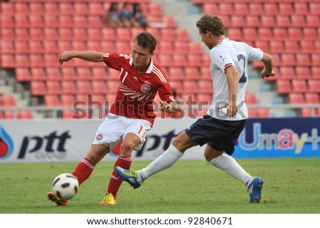 BANGKOK THAILAND - JANUARY 15 : L.Emil (L) in action during KING'S CUP 2012 between Denmark vs Norway on January 15, 2012 in Rajamangla Stadium,Bangkok, Thailand.